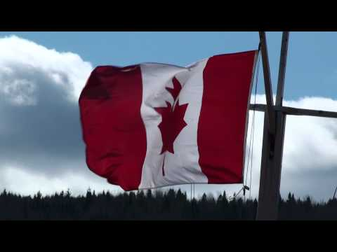 Canadian Flag Waving in the Fall Countryside Wind