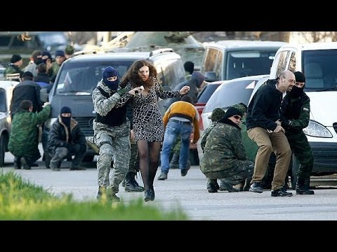 Russian forces storm Ukraine's Crimea bases