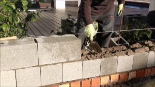 Construcción de muro de bloque de hormigón