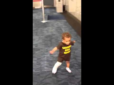 Baby TaMari running in the airport with a full leg cast