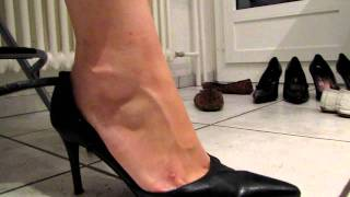 Black Ankle Straps High Heels Dangling In The Kitchen