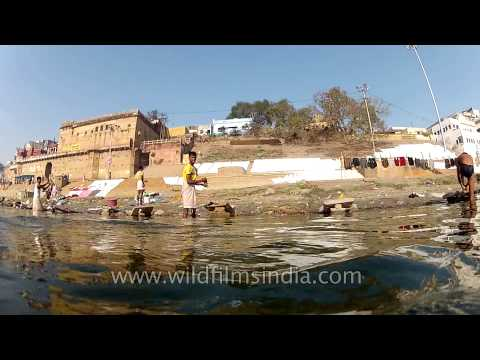 People bathing and washing clothes in the ghats of Varanasi
