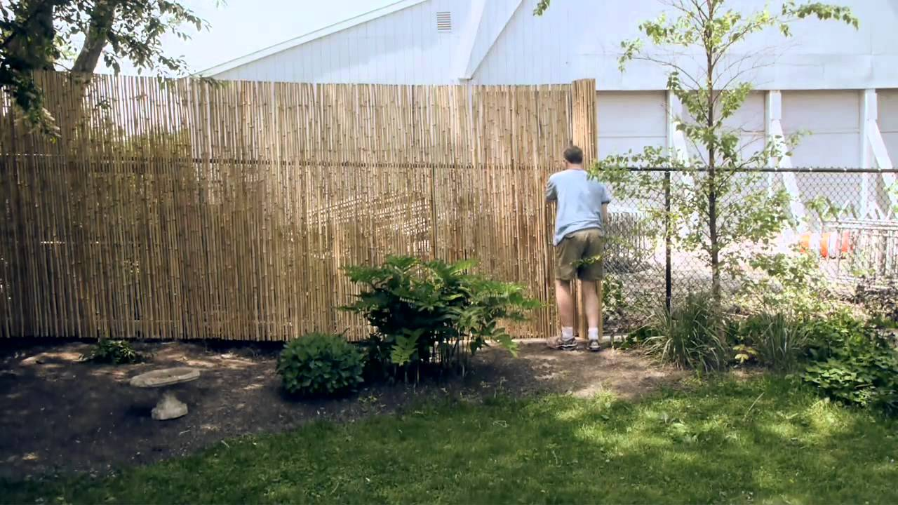 installing a bamboo friendly fence on a chain link fence. Black Bedroom Furniture Sets. Home Design Ideas