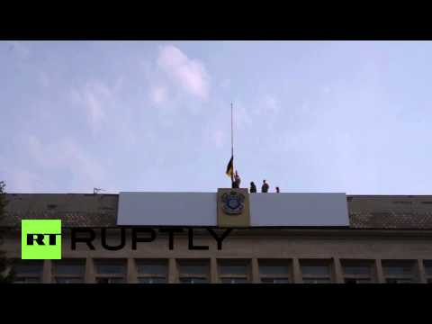Ukraine: Ukrainian flag flies high over former Kramatorsk DPR hq