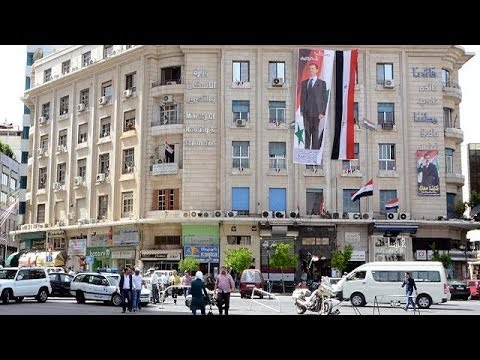 Syria claims large turnout in presidential election set to bolster Assad regime