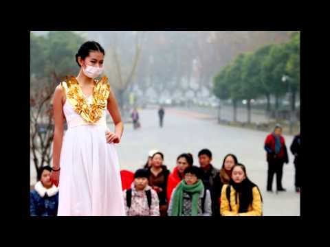 Fashion Show Models Wear Masks due to China's Bad Air Pollution