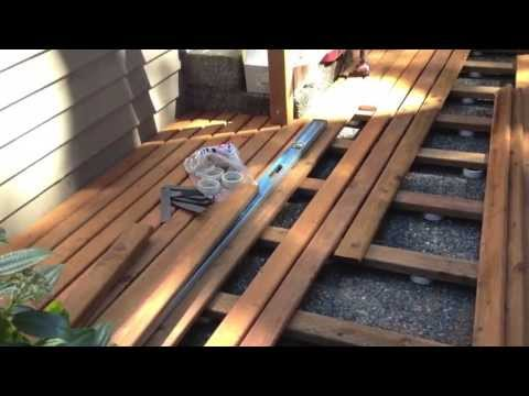 how to build a timber deck over concrete