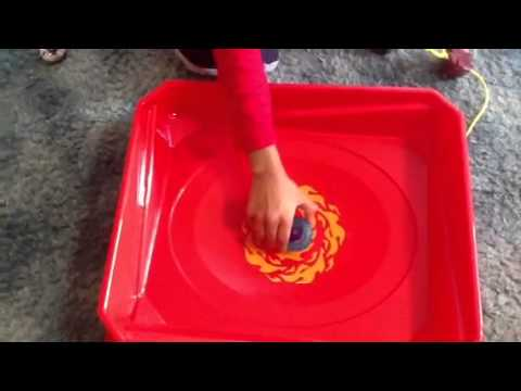 BeyBlade battle in the stadium