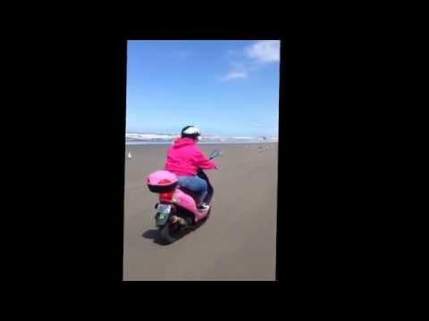 Cruising  the beach on a moped in Ocean Shores.