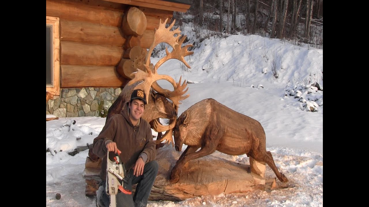Fighting caribou chainsaw carving by jordan anderson youtube