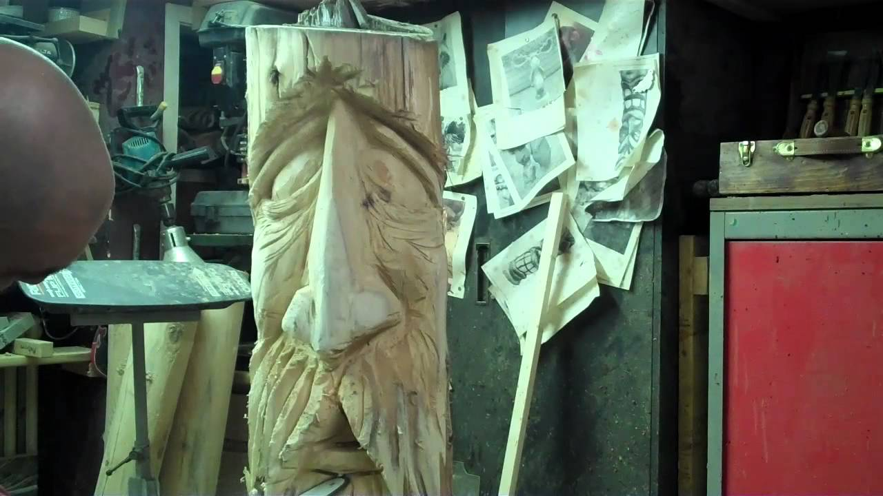 Chainsaw carving a woodspirit step by john melo youtube