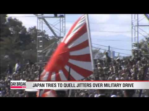 Japan tries to quell jitters over its military drive