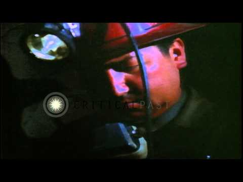 Workers drill a  mine in Bolivia and ore of tin is unloaded. HD Stock Footage