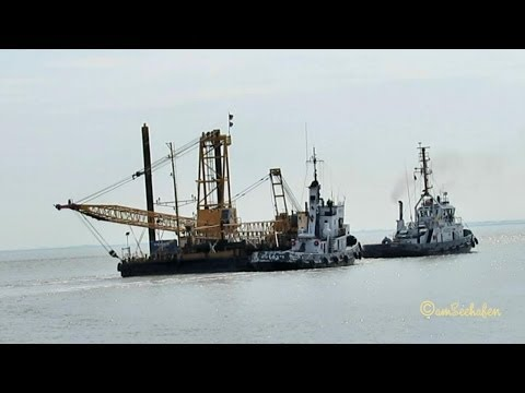 Tugboats RADBOD DEEN and WEGA DEKE towing barge with crane tug tugs Schlepper Emden Germany