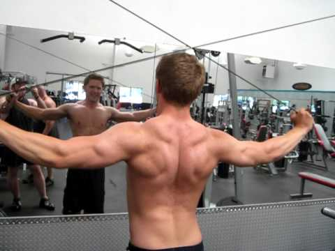 Sam Schrader Demos Overhead Rear Delt Cable Flyes - YouTube