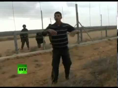 Israeli Soldiers SHOOTING at Innocent & Un Armed Young Men at Gaza   Israel Border