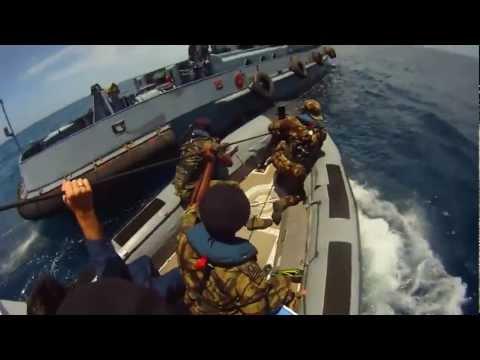 Mozambique Soldiers Board Suspected Pirate Ship at Sea - Somali Pirates