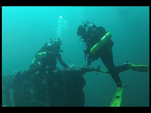 Scuba diving on the shipwreck of the Stolt Dagali