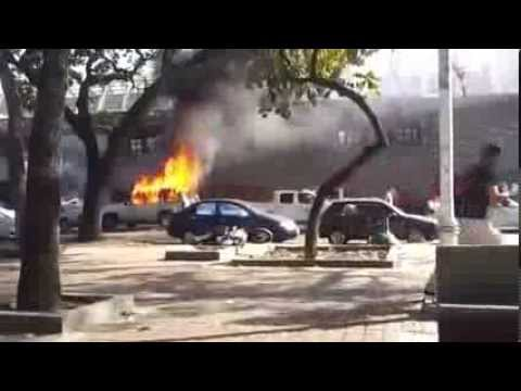 Violent Street Protests in Venezuela February 2014 - Police is using real guns to shoot!