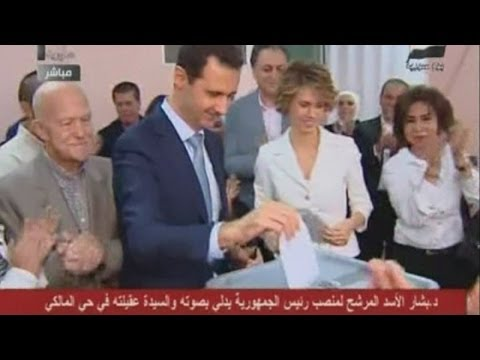 Assad supporters cast ballots with blood in Syrian presidential election