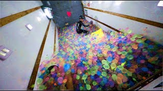 We Put 25,000 Water Balloons In A Moving Truck
