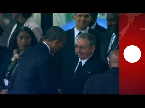 Historic handshake: Obama greets Cuba's leader Raul Castro at Mandela memorial