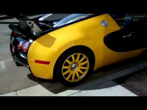 What celebrity drives a black and yellow bugatti