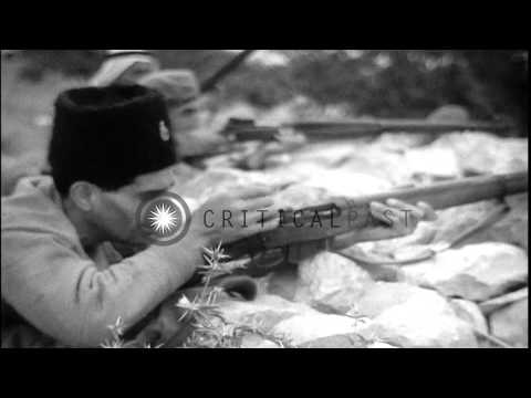 Arab troops firing rifles in a battlefield of Jordan during Arab-Israeli War. HD Stock Footage