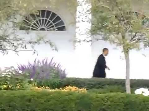 President Obama walking at the White House