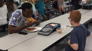 Football player's picture with autistic boy goes viral