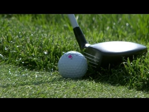 Bubba Watson utilizes fairway wood from fringe on No. 18 at the Memorial