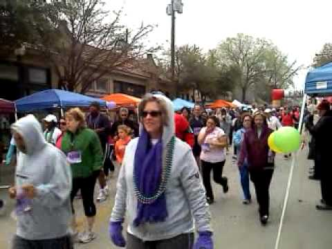 See the queen of beads, masked women (and a chicken?) at dash for the