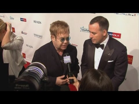 Elton John honours Hillary Clinton at annual AIDS Foundation