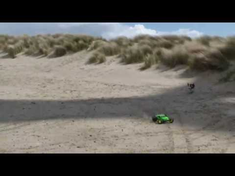 Losi XXX-T MF2 with Sand Paws and Mohawks at the beach being chased by my dog