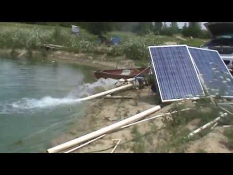 fish pond stirring using a trash pump solar panels pumping pond youtube. Black Bedroom Furniture Sets. Home Design Ideas