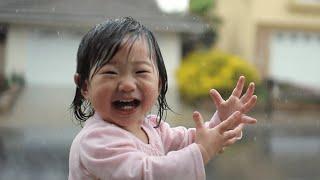 Little Girl Experiences Her First Rainfall