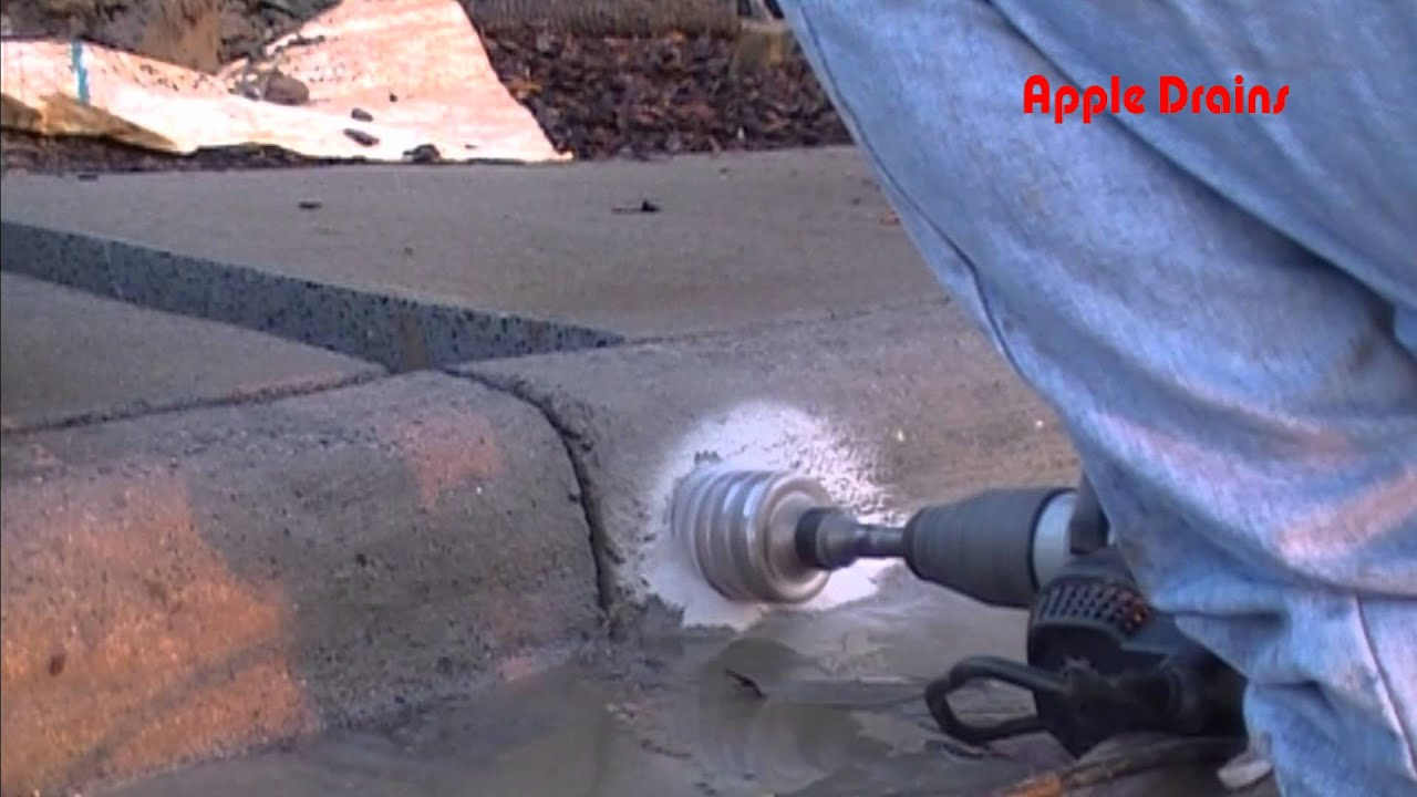 Boring A Curb Hole Discharge For Drainage Youtube