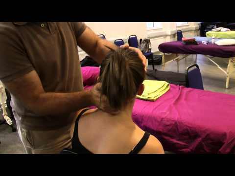 Talk To The Brain (TTTC) massage approach in a seated position