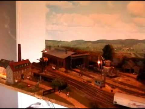 HO steam locomotive with sound on beautiful model train layout