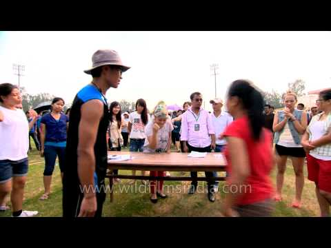 Women arm wrestling competition at the Naga Fest'13-Delhi