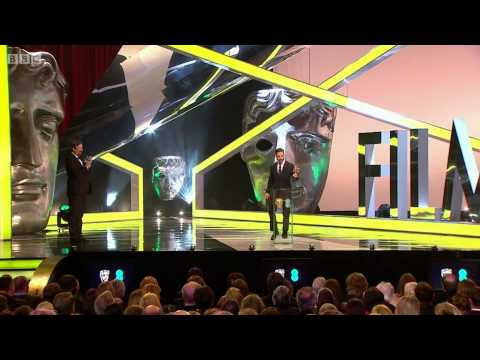 Tom Hardy presenting best actress award at BAFTA 2014