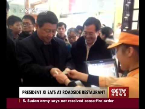President Xi Jinping eats steamed bun at roadside restaurant