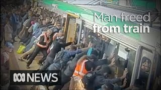 People power frees man trapped by Perth train