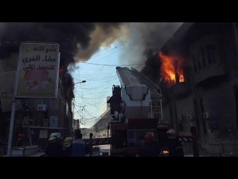 Historic Baghdad market burns after bomb blast