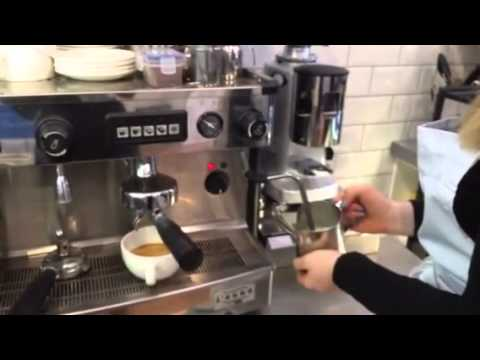 A Rex Bakery barista shows how to make coffee