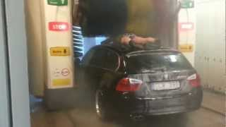 Crazy Man Coming On His Car Into The Car Wash