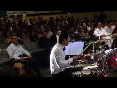 Quoc Khanh play drum and sing