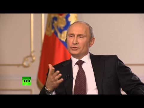 Putin: Russia doesn't defend Assad, we defend international law