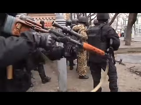 Riot Police Berkut and snipers fire at the protesters in Kyiv Ukraine