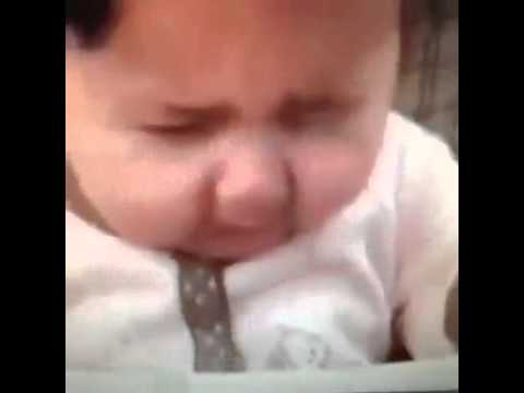 Baby tastes lemon for the first time